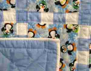 Chilly Penguins in Blue a handmade baby quilt